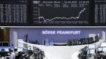 World stocks stay near all-time high after Fed signals